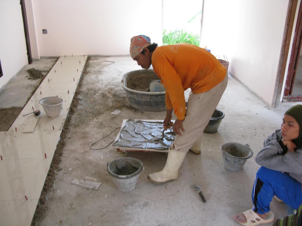 laying granito tiles